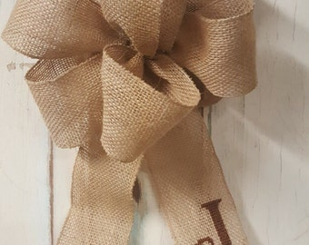 Burlap bow with cross stitch monogram letter. Great for your front door wreath or home decor needs.