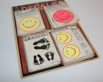 Impko Decals 1960s Smiley Face & Feet Display 52 Decals NOS Flower Child Hippie Woodstock