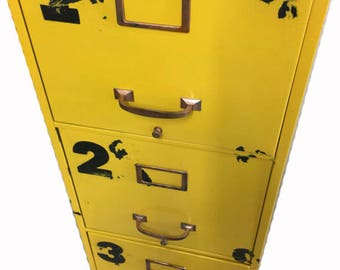 vintage industrial file cabinet with four drawers in dark rustic yellow