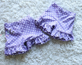 Double ruffle knit shorts in light purple with white dots.  Size 12 months and 3.