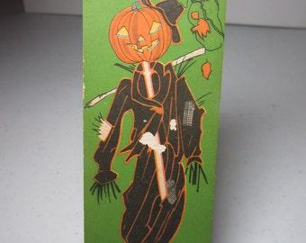Vintage 1920's-30's unused art deco colorful Halloween bridge tally Jack O' Lantern head scarecrow hanging on post