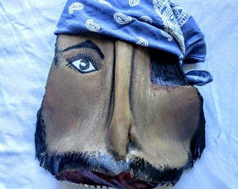 Pirate head, painted palm frond, wall decor