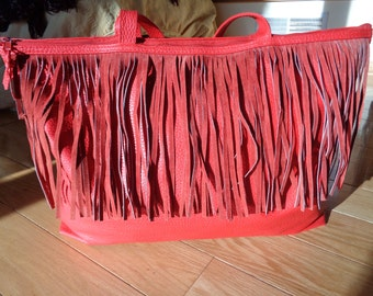 FRINGE &  RED PLEATHER  Purse with great red real suede trim finish in Vintage Condition that is large and can hold many things to carry