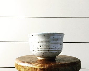 Vintage cream speckled pottery