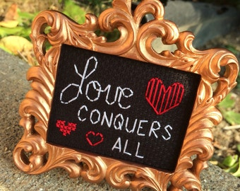 Mini Rose Gold Baroque Framed Cross Stitch - Love Conquers All