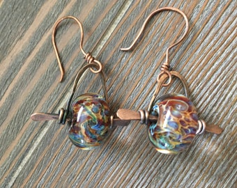 Hand forged copper earrings with beautiful lampwork beads