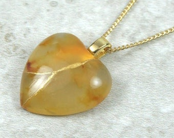 Broken heart pendant in carnelian stone with gold kintsugi (kintsukuroi) repair on gold plated curb chain - OOAK