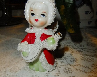 Vintage Swedish Sprinkles figurine - Angel in red coat - Playing instrument