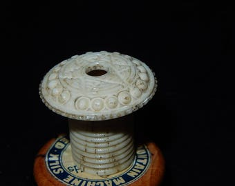 Antique miniature carved bone ribbon holder ex tape measure sewing item Regency early Victorian sewing collectable
