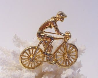 Gold tone Bicycle Brooch with Rider and Moveable Wheels