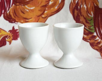 Two vintage egg cups...soft boiled eggs.