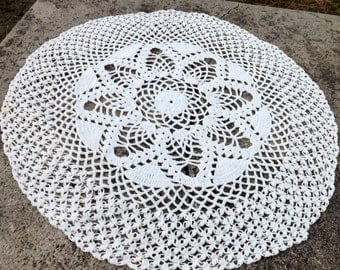 Hand crocheted round doily in snowy white
