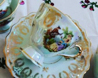 Louvre golden souvenir tea cups Limoges