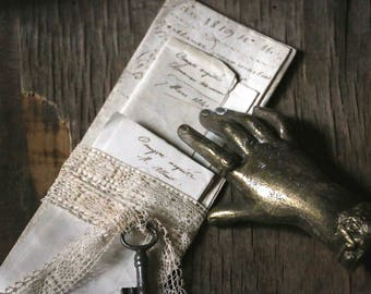 Bundle of 3 old handwritten letters  an old little key  and old lace ribbon.