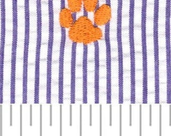 High Quality Embroidered Seersucker by Fabric Finders–  Orange Paw Print in Purple Stripe