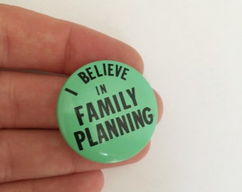 i believe in family planning vintage pinback button
