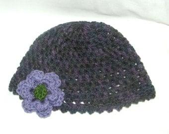 Purple beanie hat with flower