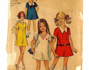 "A Short Sleeve A-Line Dress with Neckline, Collar, Pocket and Trim Variation Sewing Pattern: Girls Size 10, Breast 28-1/2"" • Simplicity 8720"