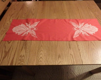 Red table runner with white angel