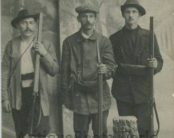 Serious men hunters posing with rifles guns antique photo