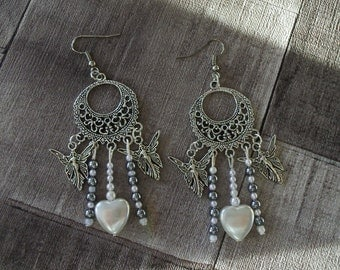 earring has charms