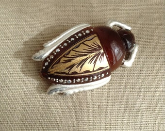 "1930's bakelite ""scarab"" brooch (amber colored)"