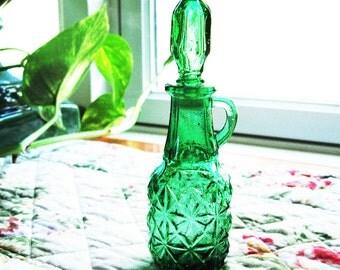 Green glass cruet bottle with stopper, perfume or vinegar bottle,  pattern glass, daisy or starburst pattern
