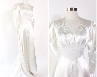 1940s ivory liquid satin wedding dress with train / white beaded waist and accents / poufed sleeves / button back / vintage 40s pinup bride