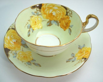 Antique  Aynsley green and gold Tea Cup And Saucer, English tea cup and saucer set, blossom flowers on mint green