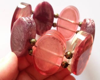 Bracelet - pretty pink and mauve swirly plastic wood beaded elasticated bracelet
