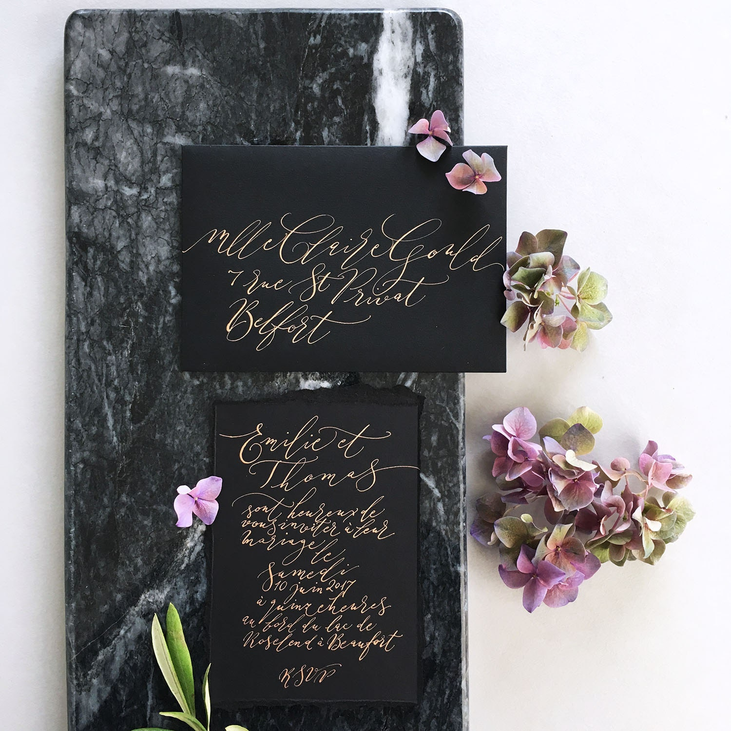 exquisite modern calligraphy lettering with a marble backdrop By Moon and Tide