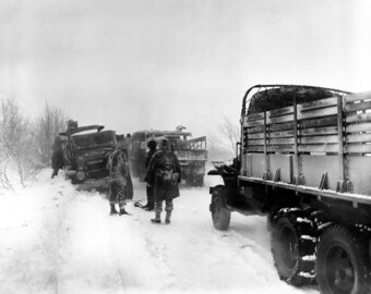 US Army vehicles, snow covered road, WWII, Belgium, WW2