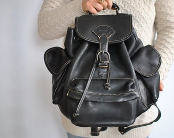 Vintage LEATHER BACKPACK ..........(510)