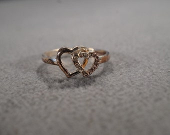 vintage sterling silver statement ring with two entwined hearts, size 8   m2