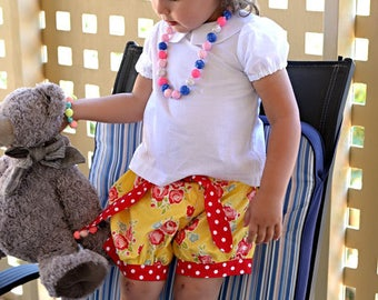 Girl's Bubble shorts bloomers in gorgeous yellow floral fabric with contrast tie belt and cuffed legs size 1