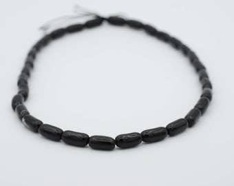 "6x14mm Rice Shape Black Coral bead, 18"" long 17.5 grams"