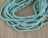 2-3mm Baby Blue Coconut Shell Pucalet Rondelle Beads Dyed and Waxed 15 inch strand