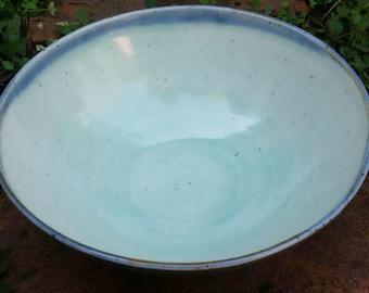Light blue speckled glazed Ceramic Bowl with blue contour rim