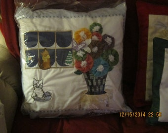 Pillow cover, these have YoYo's. each one is somewhat different, I have many different covers, no 2 are alike,