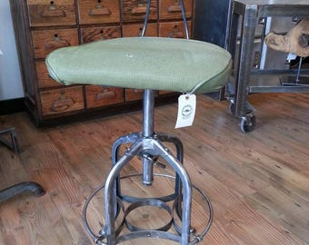 Vintage industrial adjustable Toledo stool with original upholstery