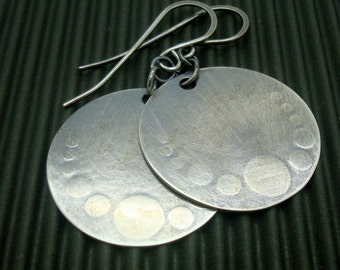Embossed Disc Earrings in a Medium Size that are Oxidized Sterling Silver with Dots