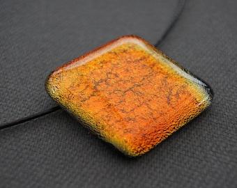 Orange pendant fusing. Dichroic glass.