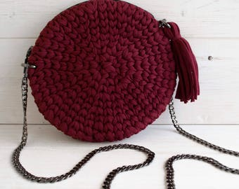 Ready! Burgundy round bag with chain handle.