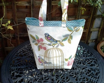 Birds on a cage oilcloth with deep green polka dot lining, tote / book / shopping bag