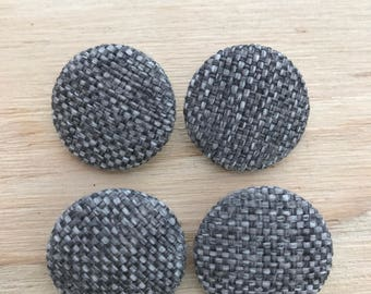4 pack upholstery buttons with metal loop backs. Size 36 (approx 23mm button dia.) grey woven fabric.