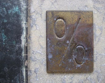 a small vintage french brass embossing block, %, percentage sign