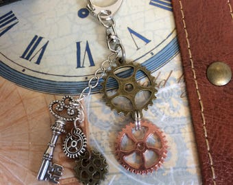 Steampunk Key chain, Silver with  Mixed metal cogs, gears and a silver alloy key. Can be used as a bag or purse charm or key ring.
