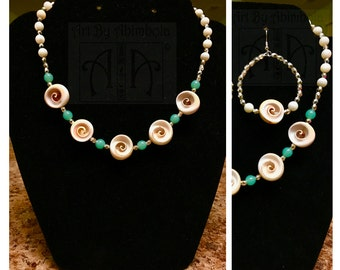 Natural shell and bead necklace with soft green tones and silver accents and matching earrings