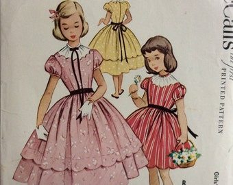 McCall's 9525 vintage 1950's girls dress in two lengths sewing pattern size 4   Uncut  Factory folds