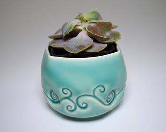Porcelain planter sleeve in beautiful aqua translucent glaze - great for a desk or a window sill